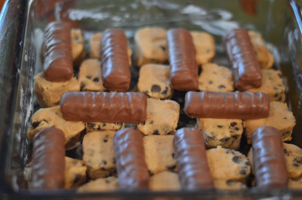 Twix and chocolate chip cookie brownies are the perfect addition to any Halloween party! It's a super easy dessert for Halloween and every other party during the year!