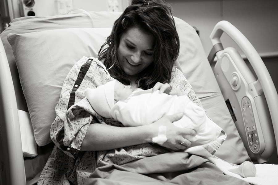 Hiring a birth photographer is one of the best things a new mom can do. This is Paislee's birth story.