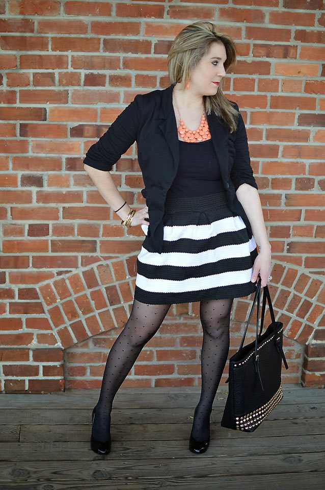 Life and style blogger, The Samantha Show, shares a trendy black and white outfit paired with a bright pop of color to pull it all together.