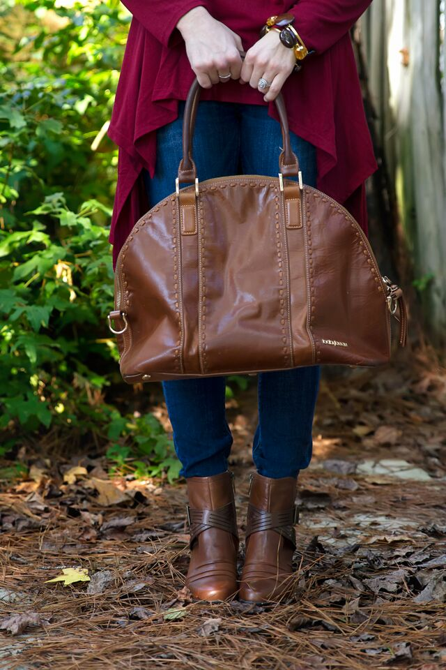Neutral outfit with a burgundy tunic.