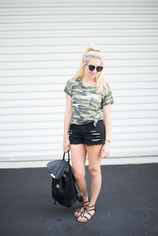 Summer style; camo tee tied in a knot, black ripped jean shorts and strappy sandals. Simple, chic, and trendy looks for women of all ages.