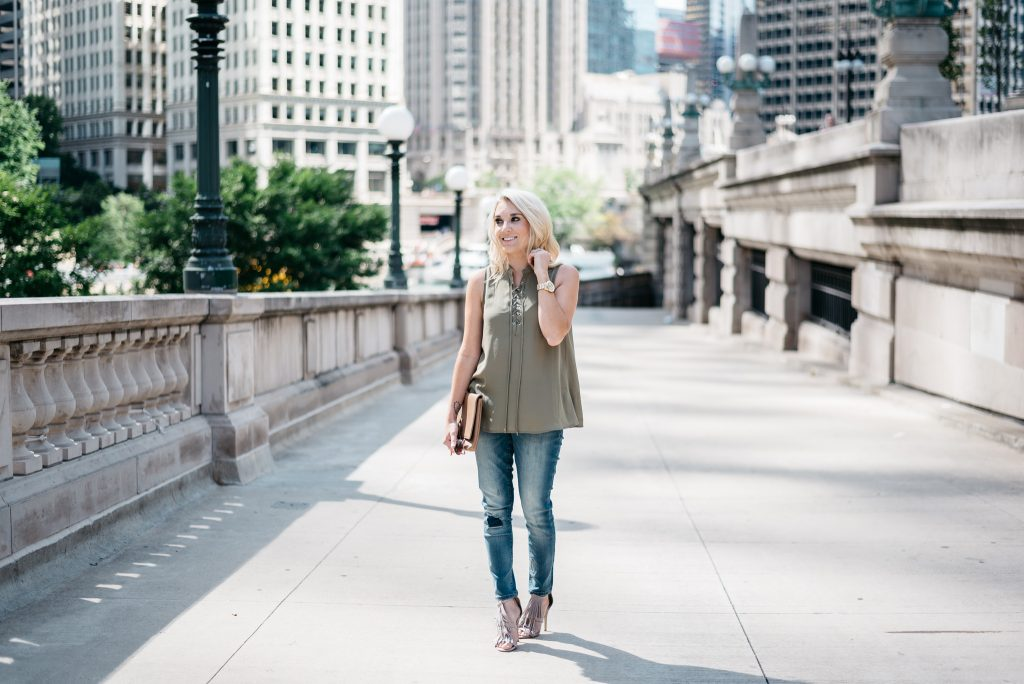 When transitioning from summer to fall with jeans it's important to mix different pieces that can balance each other. Mixing jeans with sleeveless tops and open toed shoes help keep your fall look light and airy.  Click through to see more tips!
