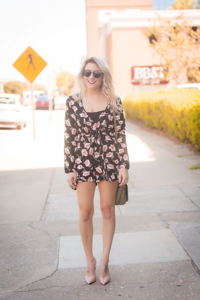 Black floral romper from Mo and Cho Boutique; pair with a pair of pumps for the perfect nighttime look.
