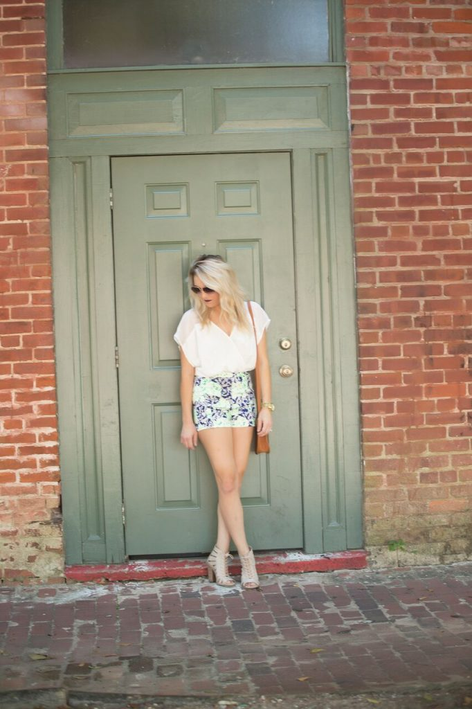 Perfect summer romper from Mo and Cho; neutrals with a pop of color.