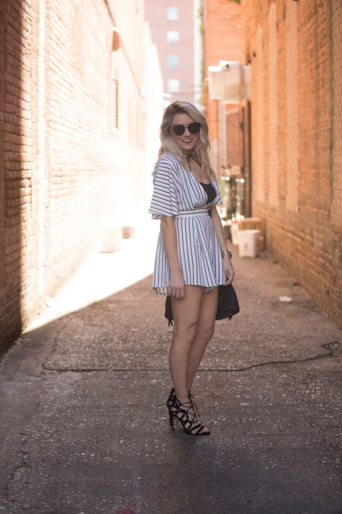 Striped romper from Mo and Cho Boutique; pair with a pair of strappy heels for the perfect nighttime look.