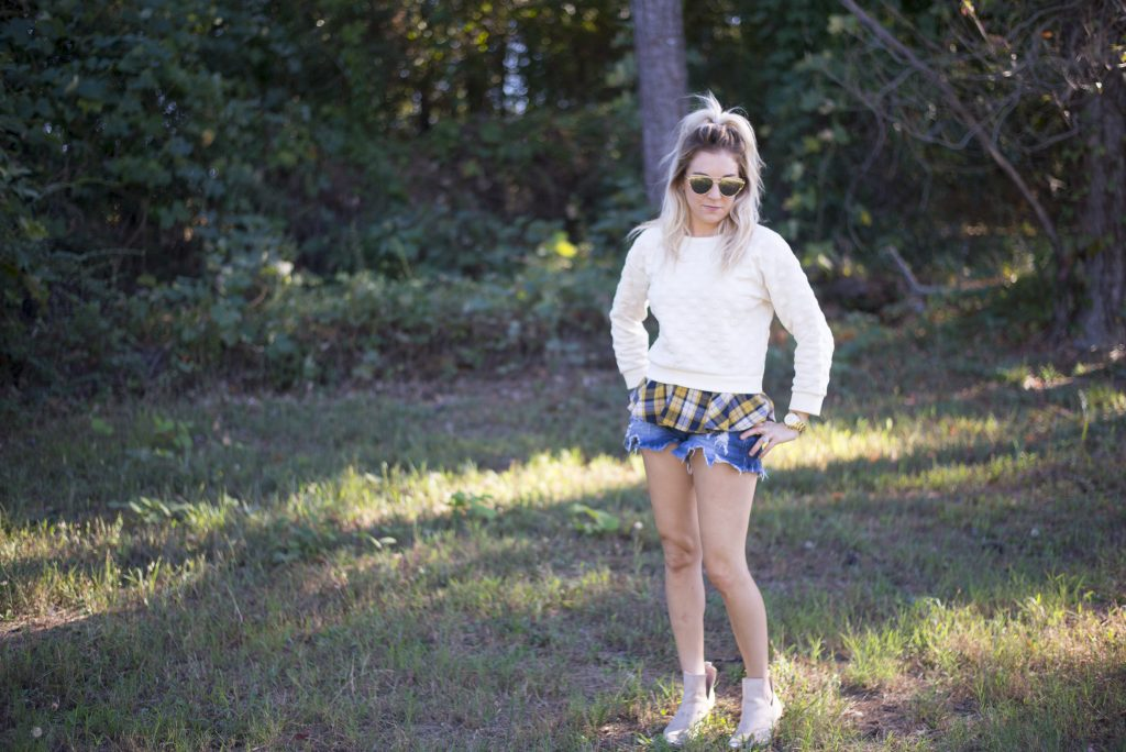 Sweater + Plaid. Pair your favorite sweater and plaid flannel underneath (this one is actually attached) and you've got the ultimate look for fall!
