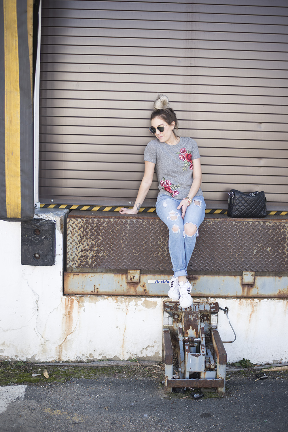Embroidered roses tee paired with jeans and tennis for a comfortable but chic daytime look.