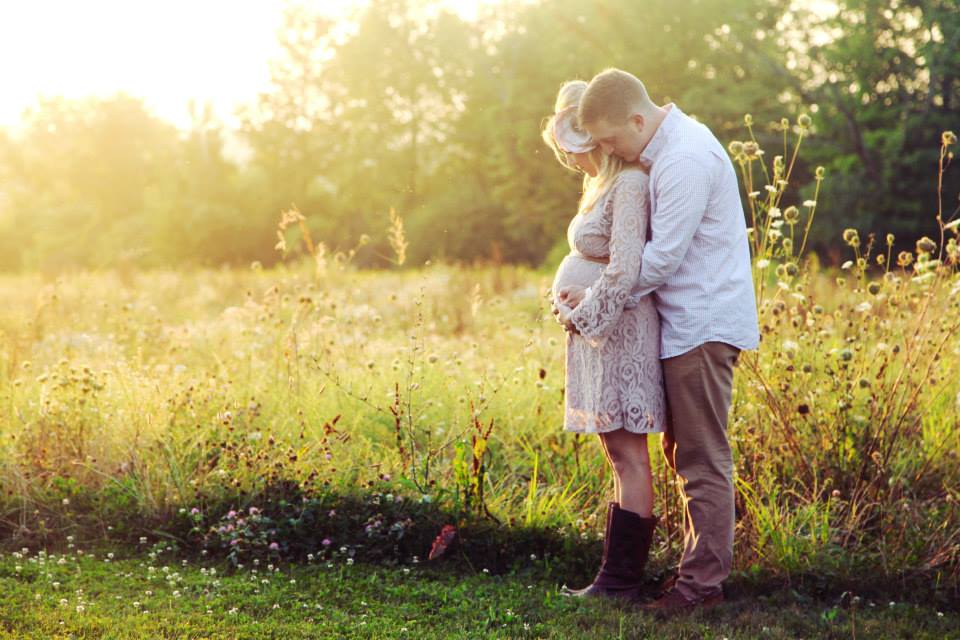 maternity photos in field at the golden hour