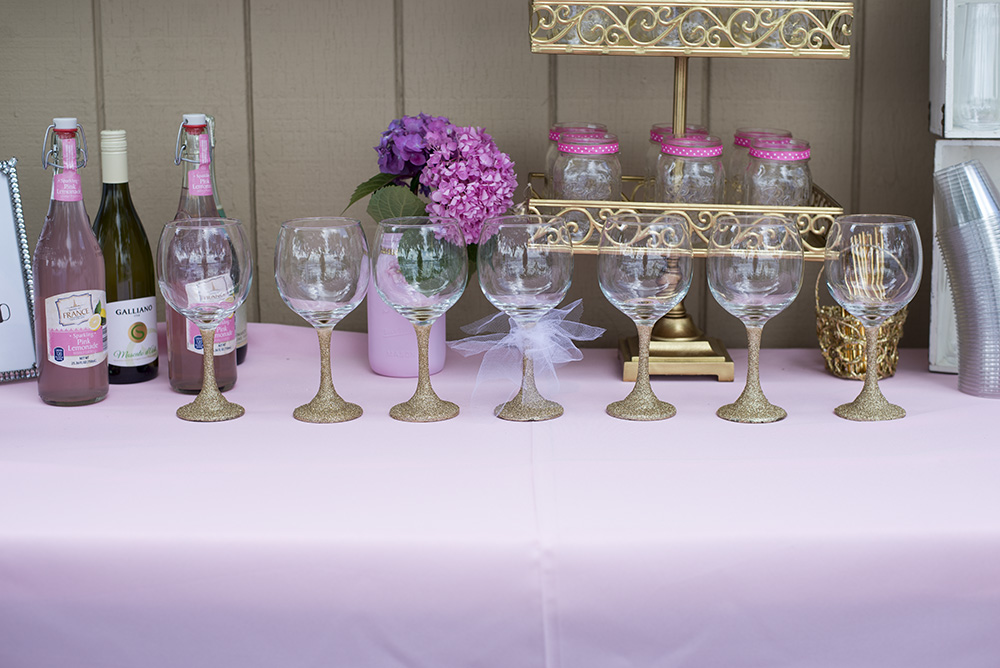 How to throw the perfect pink and gold bridal shower. Everything from DIY Glitter Wine glasses to a wine bar!
