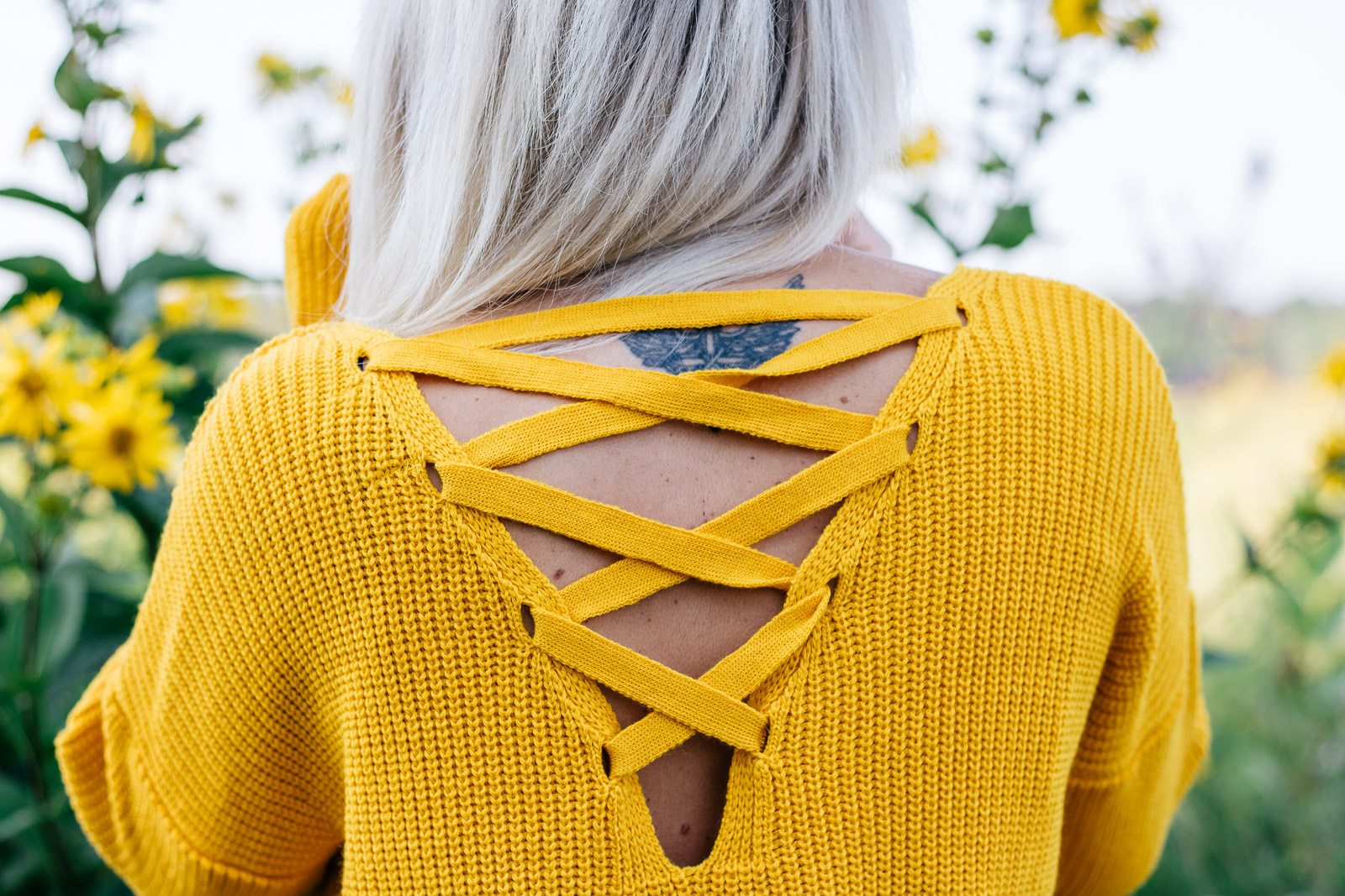 Fall vibes: mustard oversized sweater with suede lace up booties.