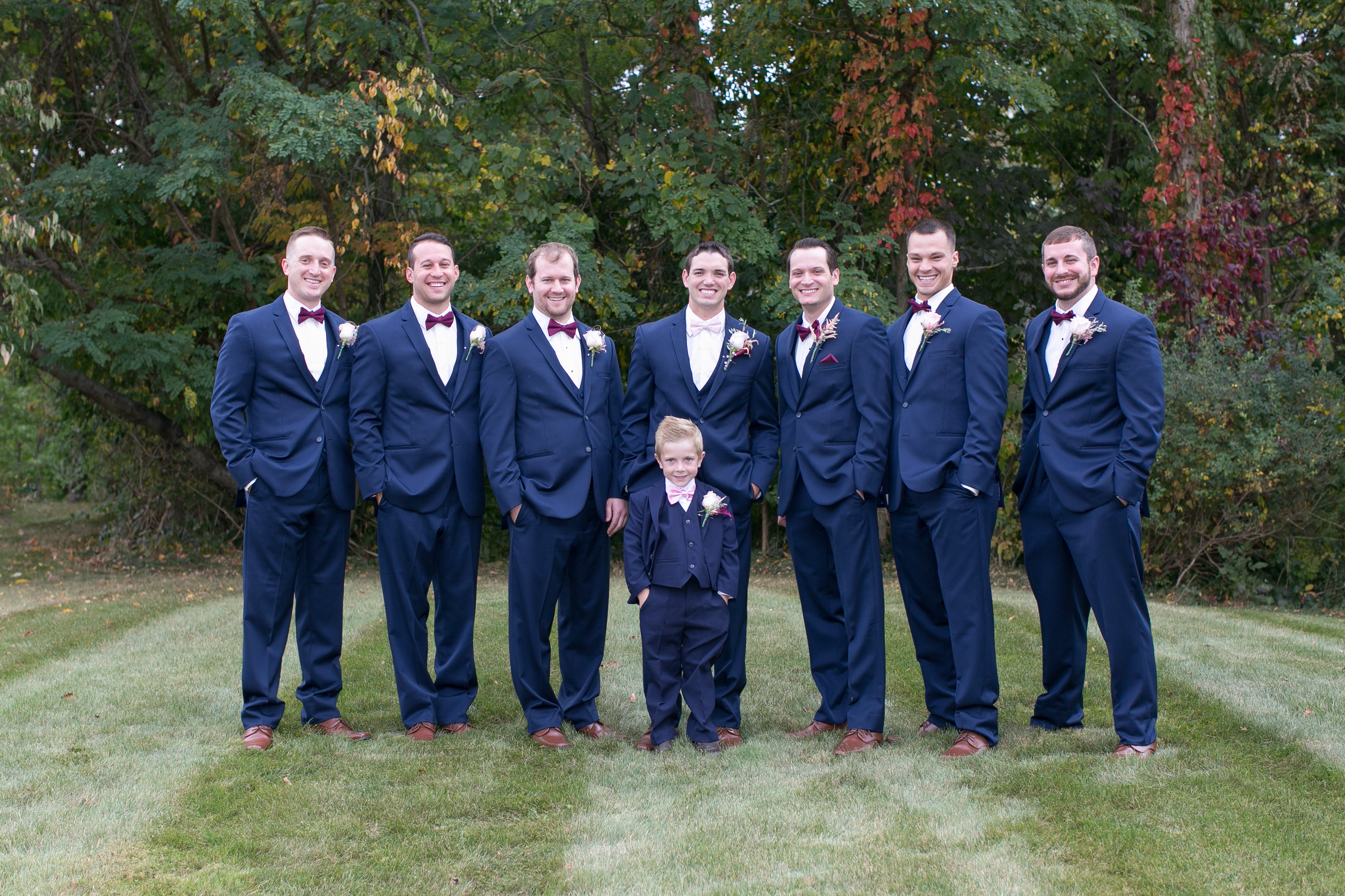 A perfect fall wedding; groom and groomsmen in navy and bordeaux