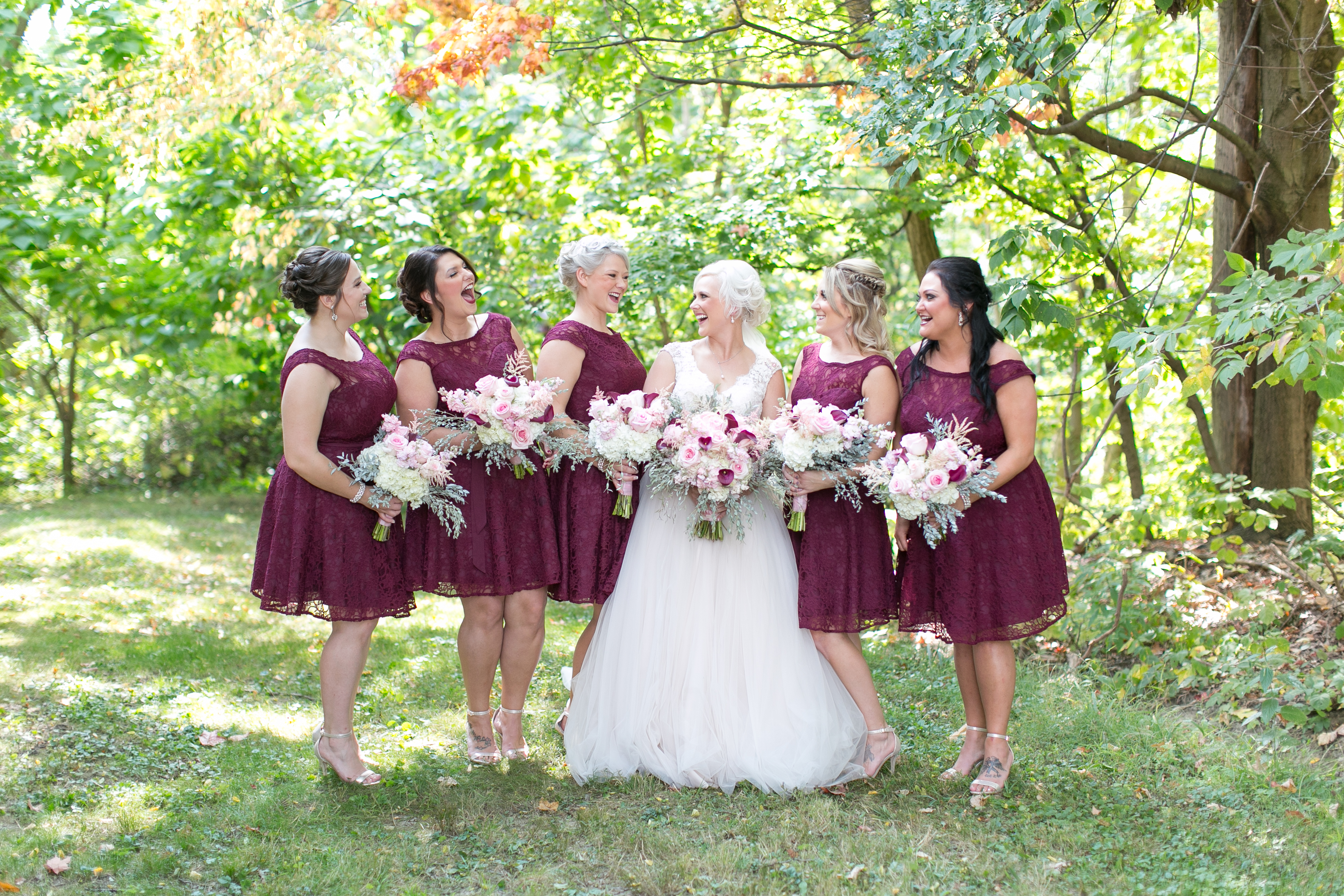 A perfect fall wedding; bordeaux lace bridesmaid dresses