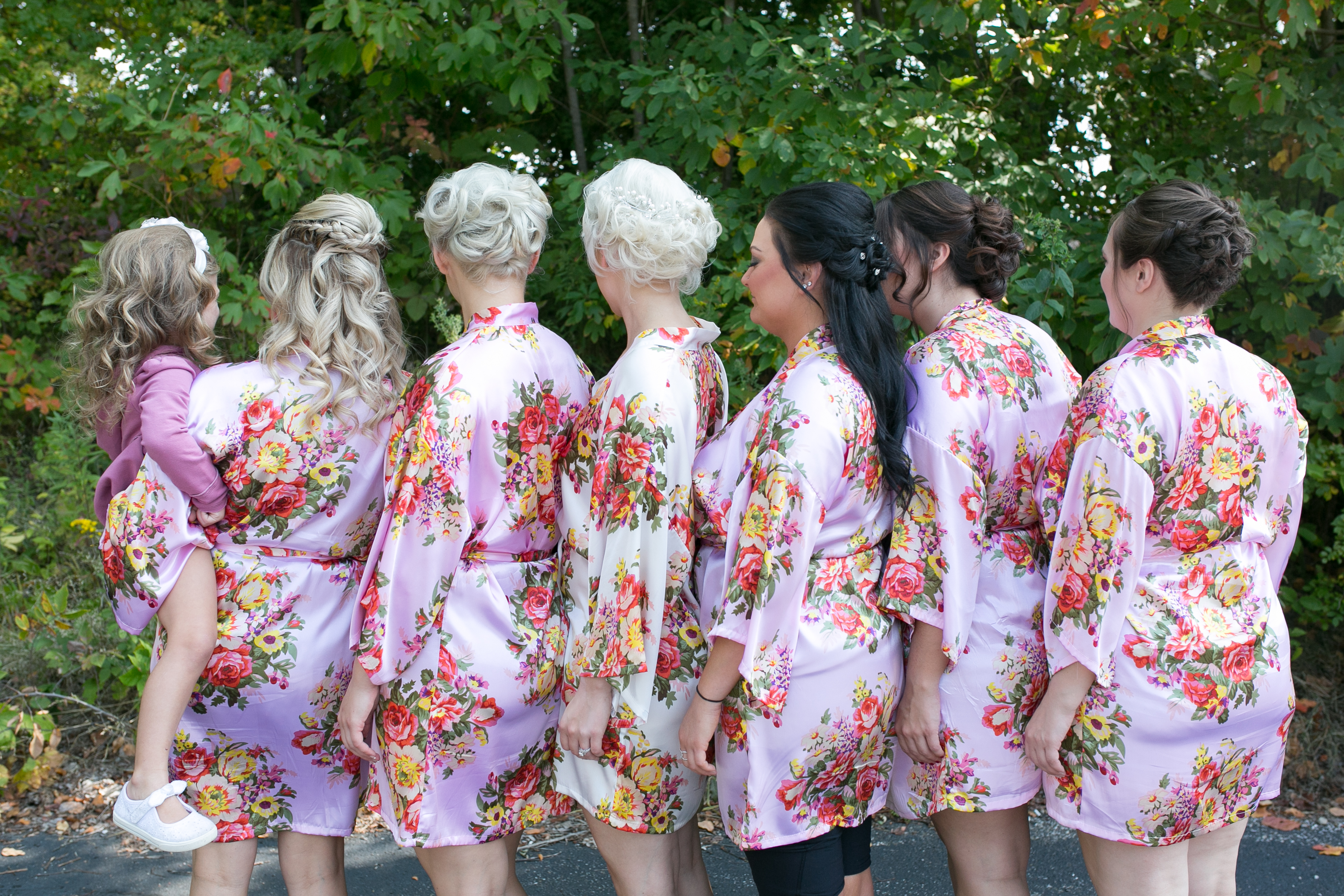 A perfect fall wedding; bridesmaids getting ready for the day in matching robes.