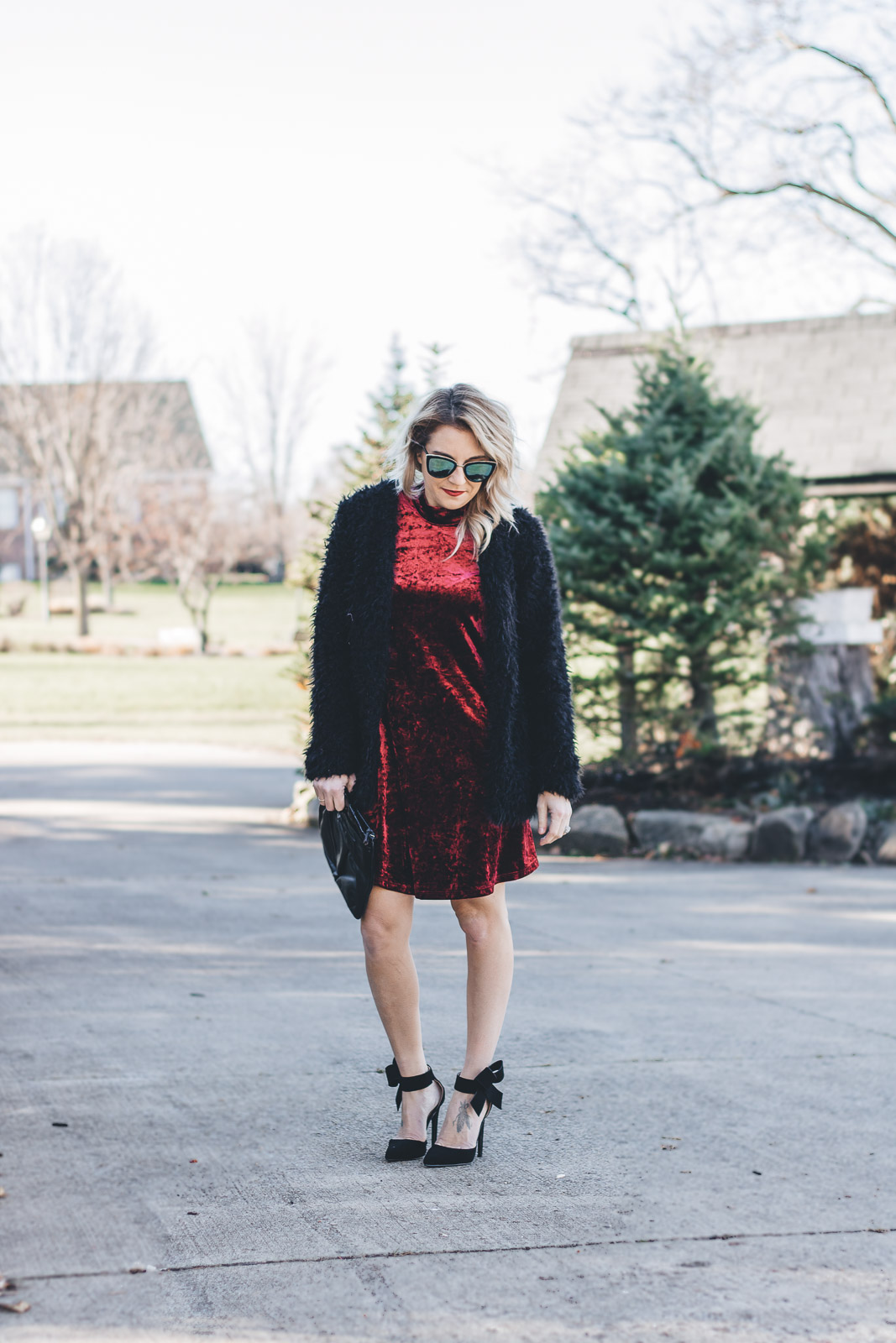 Red velvet dress with black accents for the holidays.