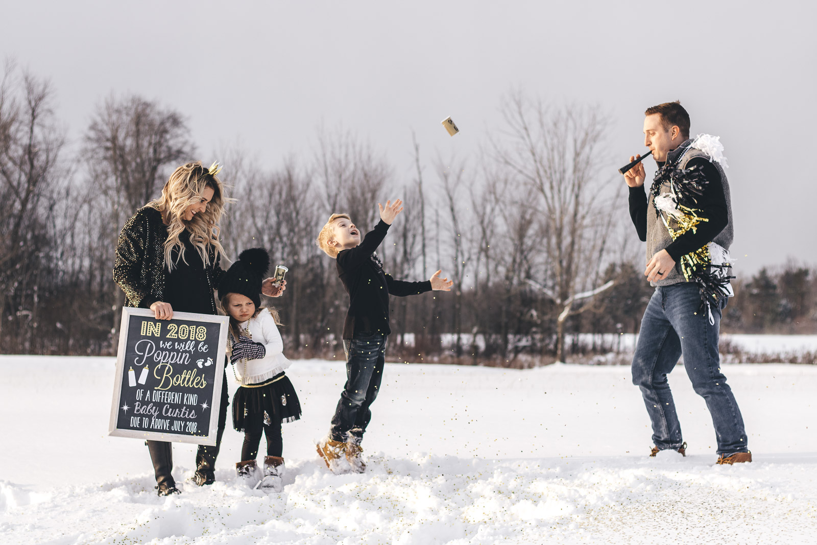 New Year's Eve Pregnancy Announcement with confetti