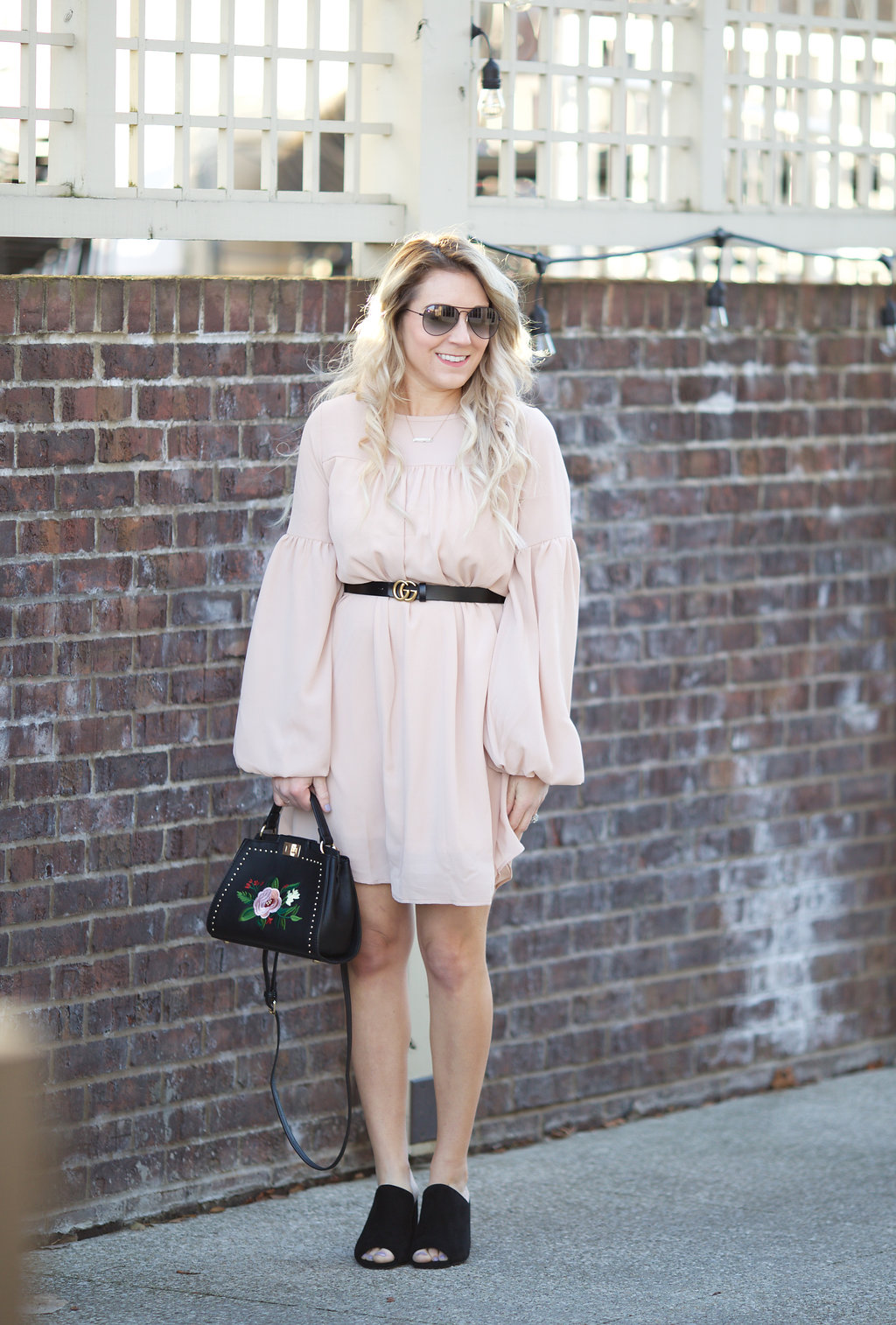 Spring style in a champagne balloon sleeve dress.