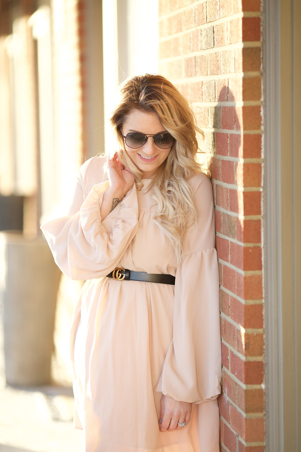 Step into spring with a feminine champagne balloon sleeve dress.
