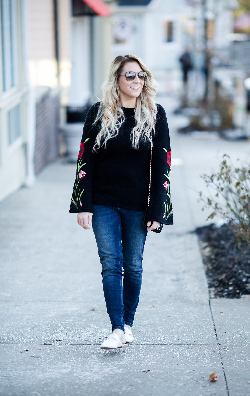 An embroidered floral sweater is the perfect way to transition your wardrobe from winter to fall!